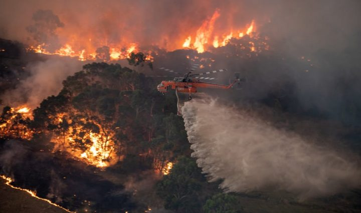 A-firefighting-helicopter-tackles-a-bushfire-near-Bairnsdale-in-Victoria%u2019s-East-Gippsland-region-Australia.-STATE-GOVERNMENT-OF-VICTORIA-720x425